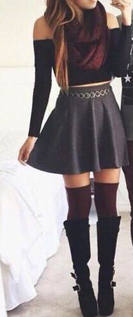 black over the shoulder long sleeve crop top, grey high waisted skirt, dark red over the knee thigh high socks, tall black boots, and dark red wool infinity scarf.
