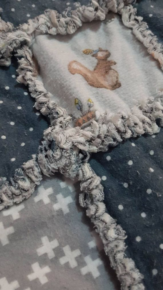 A Must Have in the nursery today, Monochrome. One of a kind.  This is a beautifully made rag quilt with gorgeous baby animals fussy cut. The greys with in this quilt will certainly tie in with any colour scheme. Machine washable in cold water Ideal for the childs cot, toddler bed or even as a floor play mat. The rag cutting of the squares will provide the wonderful chenille look of handmade quilts of yesteryear. We have washed this rag quilt to start the ragging process, which is called…