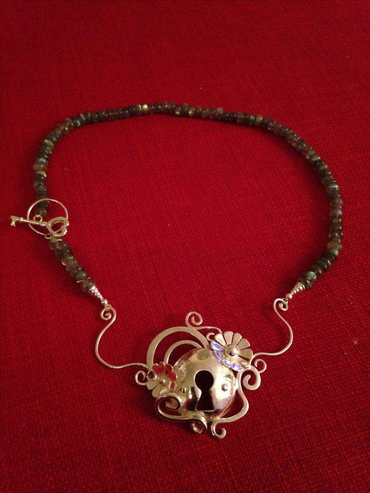 Handmade by Helen Green, using silver sheet, silver wire a labradorite.