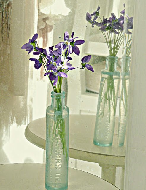violets and old bottles~ love these