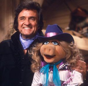 """Johnny Cash (1932-2003) was one of the most celebrated and honored country singers of all time. His signature song was """"I Walk the Line."""" His other hits included """"Folsom Prison Blues,"""" """"Ring of Fire,"""" and """"A Boy Named Sue."""" He was a member of the country supergroup The Highwaymen in the late 1980s, with Kris Kristofferson, Willie Nelson and Waylon Jennings. Cash was inducted into the Country Music Hall of Fame in 1980, and the Rock and Roll Hall of Fame in 1992."""