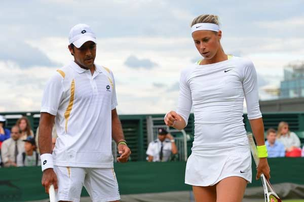Pakistan's Aisam-Ul-Haq Qureshi (L) and Czech Republic's Andrea Hlavackova (R) during their second round mixed doubles match against Britain's Colin Fleming and Taipei's Su-Wei Hsieh on day nine of the 2012 Wimbledon Championships tennis tournament at the All England Tennis Club in Wimbledon, southwest London, on July 4, 2012.