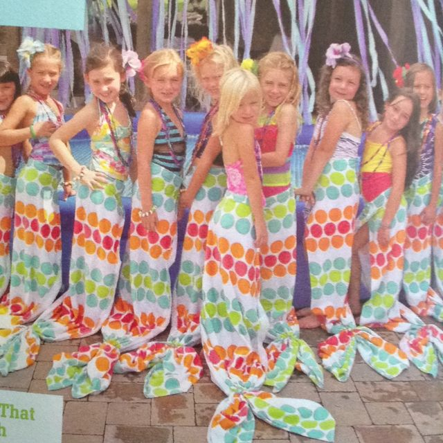 Pool party favor- mermaid tails Use beach towel. Velcro tabs at one end to secure around waist. Ponytail holders to make the flukes. (FamilyFun magazine)