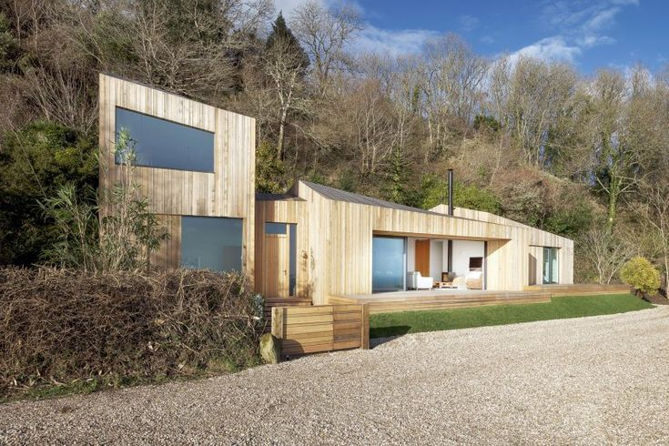 AR Design Studio replaces landslide-damaged holiday home with cluster of larch-clad blocks
