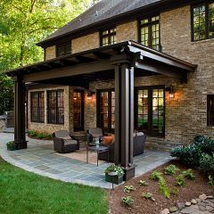 Nice outdoor seating area - add to the framing on our deck to look more like a pergola