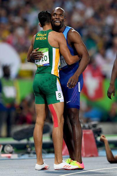 Wayde van Niekerk of South Africa celebrates with Lashawn Merritt of the United…
