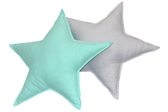 A set of stars pillows for a childrens room - 2 pieces. Pillows in various shapes are a great decoration for a childrens room, as well as nice cuddly pillows. Due to their numerous colors, sizes and textures, they will appeal to both infants and older children. The pillows fit perfectly