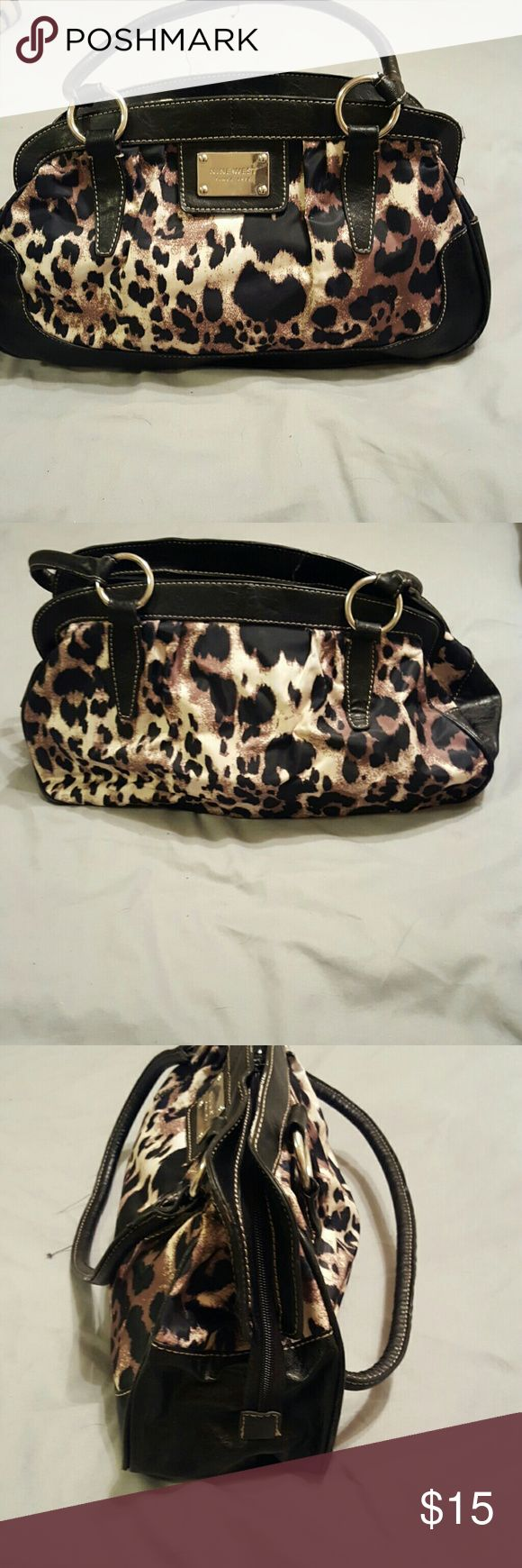 Leapard print Nine West purse Super cute Nine West bag in leapard print. Only signs of wear are a few loose threads on handles that can be trimmed off and slight wear on bottom corners, not noticeable unless looking close at the bottom. Lined inside with zip pocket. Nine West Bags