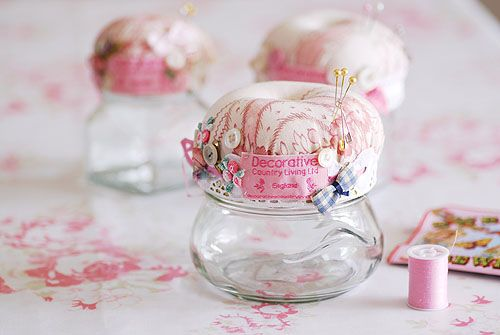 These adorable pin or button jars are made from re-cycled jam jars, covered with vintage fabric and sprinkled with a magpie's collection of buttons and trinkets.