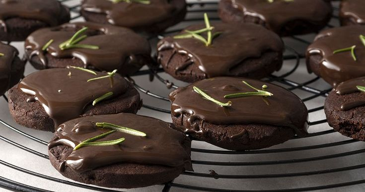 Chocolate rosemary cookies by Greek chef Akis. Wonderfully aromatic cookies with rosemary and coated in a chocolate rosemary frosting.