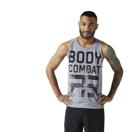 Reebok - LES MILLS BODYCOMBAT Tank: Proudly display your fit side with bold LES MILLS lettering, while Speedwick technology keeps you cool and dry in this BODYCOMBAT tank. Made for layering, comfortably wear this soft and durable workout essential to the studio, then easily switch up your look while on the go.