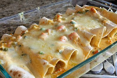 Crawfish enchiladas - 1/4 lbs (1 stick) unsalted butter, 1 c finely chopped onions, 1 c canned green chiles chopped, 3/4 c finely chopped green bell peppers, seasoning, 1/2 tsp minced garlic, 3 c heavy cream, 1 c sour cream, 8 c grated Monterey Jack cheese or other white cheese (2 lbs), 2 lbs peeled crawfish tails, 2/3 c finely chopped green onions, 1/2 cup cooking oil, 20 (6in) corn tortillas