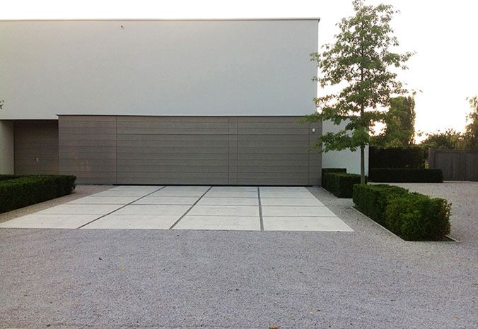 large format driveway paving set within gravel