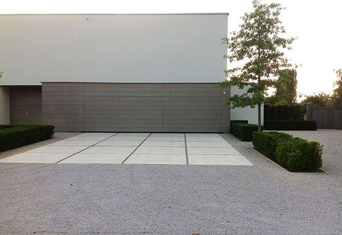 large format driveway paving set within gravel