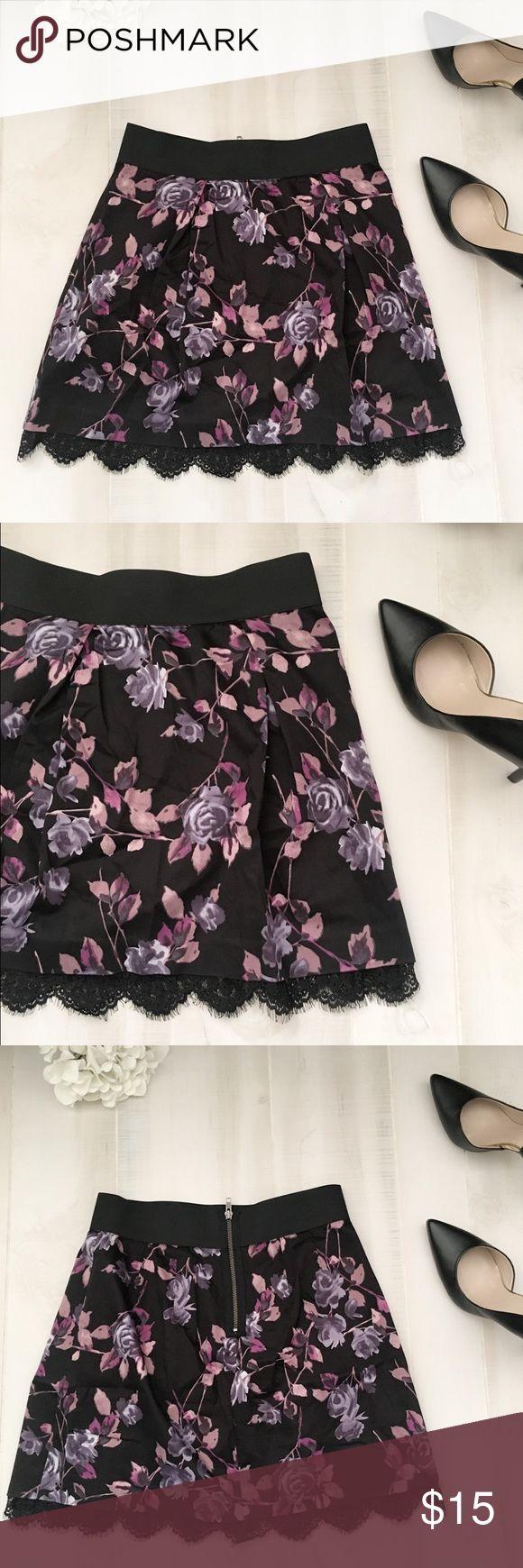 "Elle Cute floral lace hem skirt EUC Elle floral print skirt. Black base with pink, mauve, and purple multicolored flowers. Elastic stretch waist. Laced peek hem. Back zip. Size m. Waist 15"", waist to hem 18.5 Elle Skirts Mini"