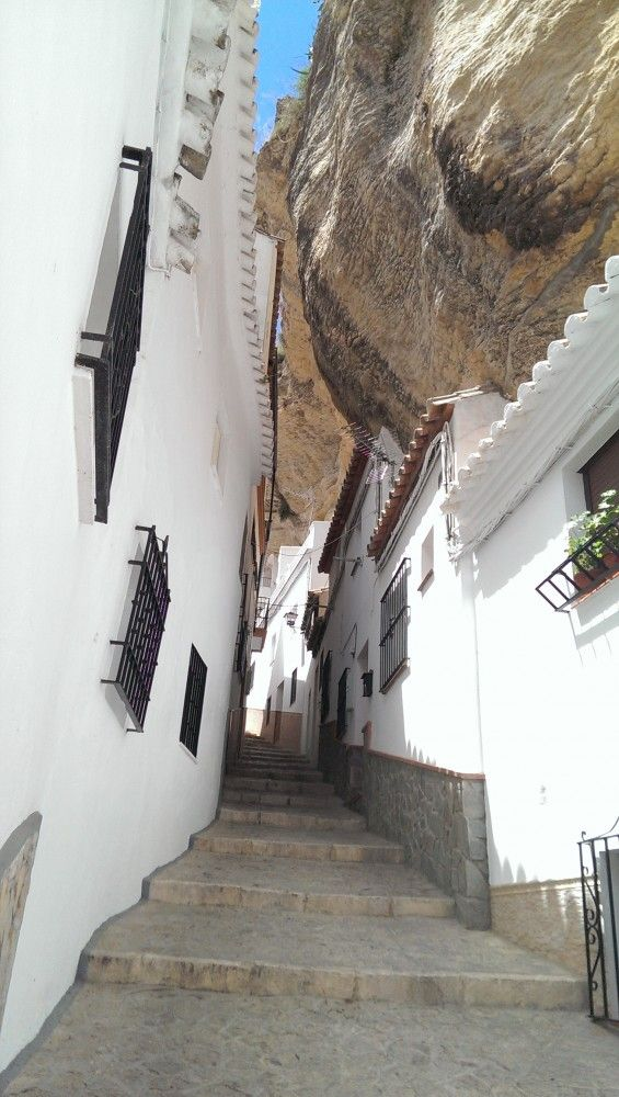 Living Under a Rock - The Andalucian town of Setenil de las Bodegas looks like something from the set of a fantasy film, but cave dwelling is actually common in Andalucia; being so close to the African continental plate, geological forces threw up mountain ranges & volcanoes that are perfectly suited for habitation. The rocks & caves make for surprisingly easy settlement & nearby Cueva de la Pileta shows evidence of a human presence up to 25,000 years ago (Photo credit: Feli García)