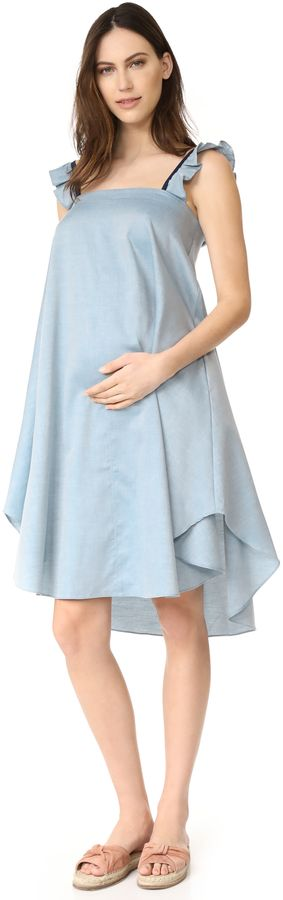 HATCH The Nelli Dress - A soft chambray dress with charming ruffled straps. Gathered elastic trims the back, and on-seam pockets detail the sides. Rounded hem.