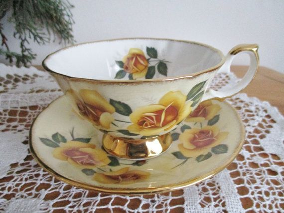Vintage Elizabethan teacup and saucer, fine bone china, english teacup, pale yellow bone china, hand decorated