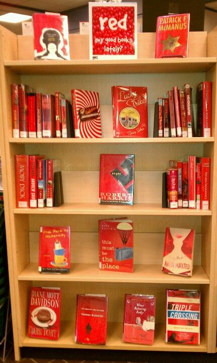 Wake County public library display of red books in February.  Cary branch. Have done this before with red and other colors and it is eye-catching & great way to highlight books in all formats & genres