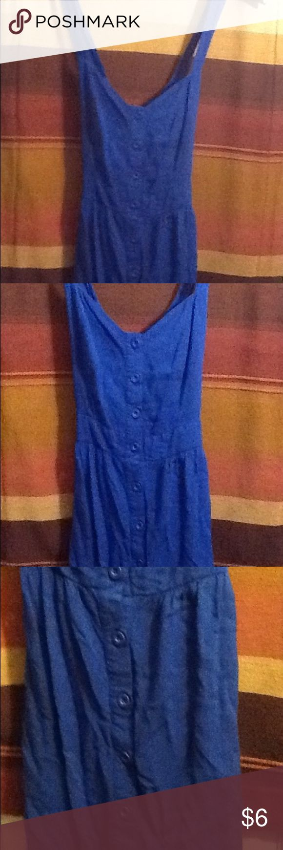Junior women's dress This is a junior women's blue dress. It is a causal everyday summer dress. It is tank top style on top, crisscrosses in the back.(6). It buttons down the front. It has pockets on the sides. Dresses Mini