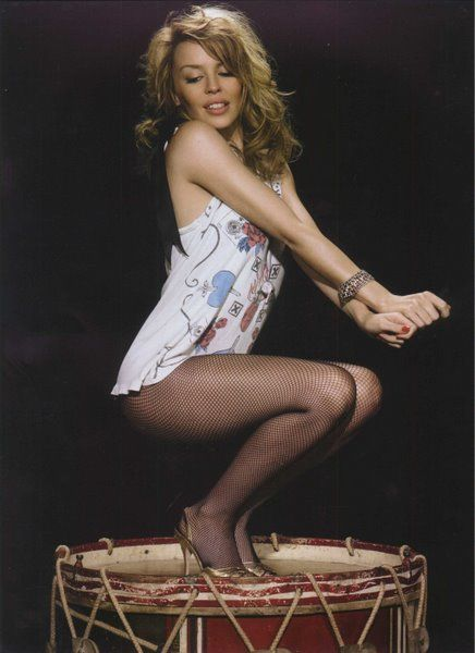 Kylie Minogue, she's 46! Even with the stress of surviving breast cancer she still doesn't look a day over 27! Absolute perfection! When they perfect cloning, I'm going to have 6 of her made! LOL!