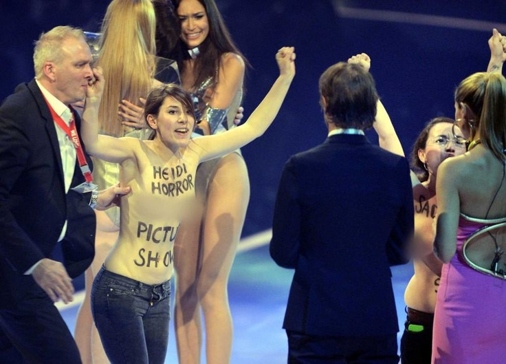 Bosom-baring protesters storm the finale of Germanys Next Top Model by Heidi Klum during a live broadcast at SAP Arena in Mannheim, Germany, on June 1, 2013.