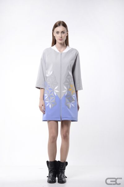 "http://cbcdesign.ro/en/shop/bomber-jacket-duo-cat/ Two toned softshell jacket with front zipper and geometric detailing. The cut-out pieces are layered based on color creating a ""trompe l'oeil"" effect. The jacket is finished with cotton, like the sleeve cuffs and the collar."