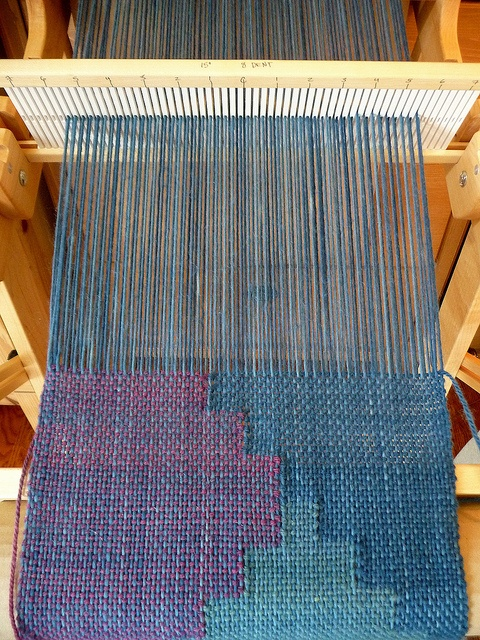 """Tapestry vest on the loom, by Nancy/Dragonfly Hill on flickr __ """"This is the Tapestry Vest pattern from Handwoven magazine Sept/Oct 2011. Warp is Lamb's Pride wool/mohair, weft is Correidale. Warp is Indigo dyed with varying depths of color, and all weft yarns are natural dyes overdyed with Indigo Brazilwood, Logwood, and Onion Skins, with a tiny bit of Cochineal)"""""""