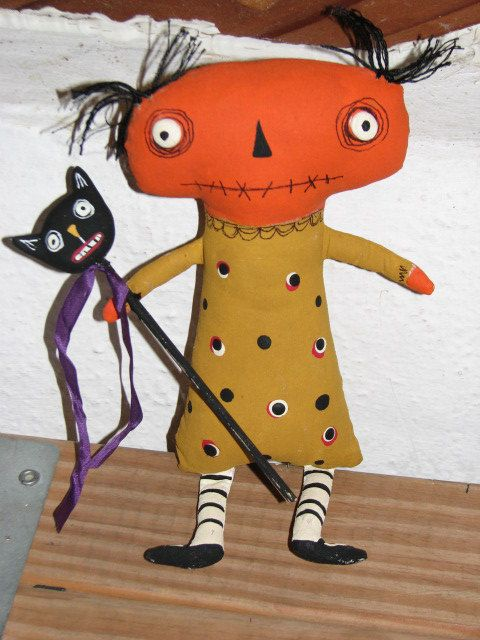 CREEPSTER DOLL ...Sewn from muslin and hand painted. Little Clay eyes with pen detail on his face. He holds a Clay Cat on a stick. Great whimsical