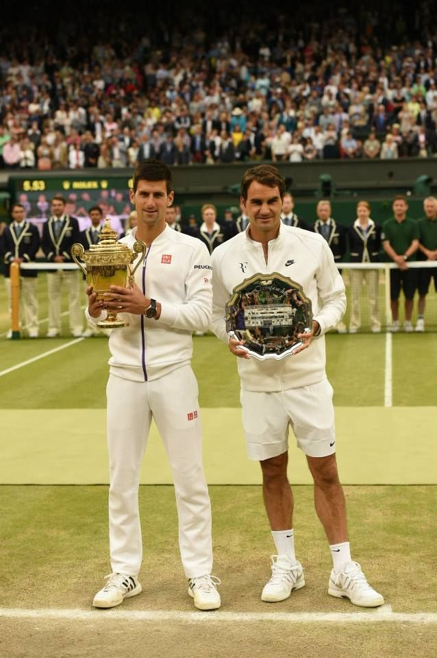 Novak Djokovic and Roger Federer on Centre Court at the trophy presentation. Wimbledon 2015