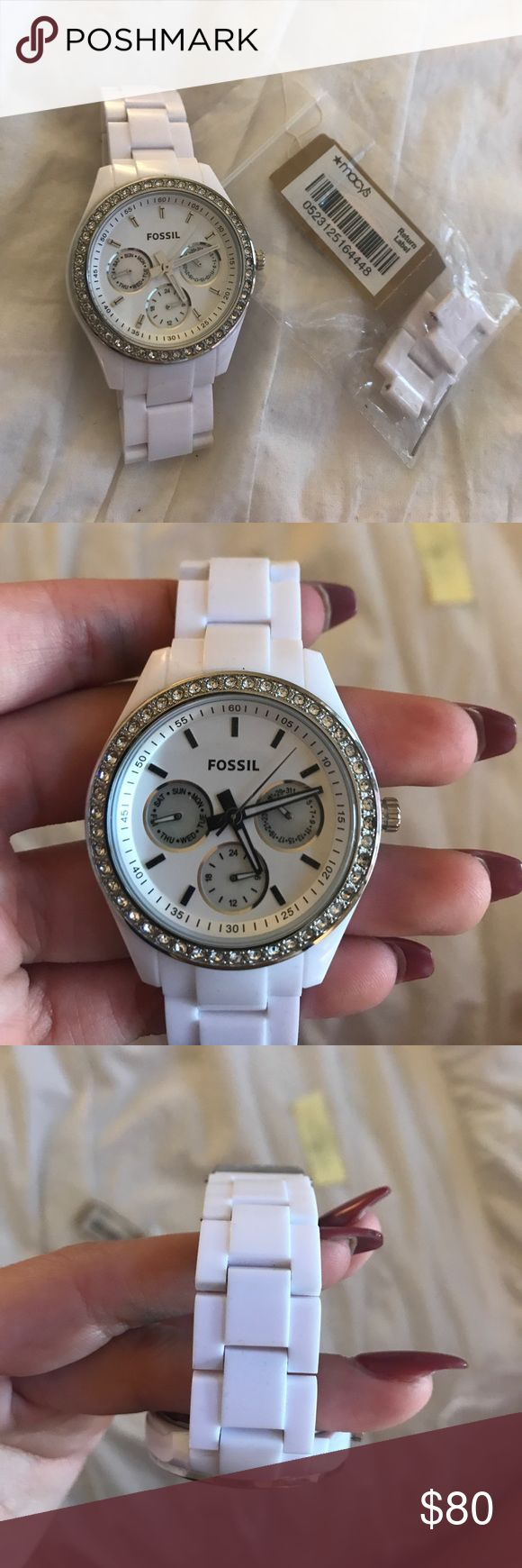 White Fossil Watch This Watch is in almost perfect condition, the only flaw is as seen in the last picture- slight scratching on back Fossil clamp. Batteries still work. Price is firm bc of condition & working function. Includes all extra pieces to make larger. Fossil Accessories Watches