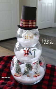 Fish Bowl Snowman - DIY craft for a beautiful and unique indoor Christmas decoration. ADORABLE! Make a little Christmas scene in each bowl. #DIYChristmas #HandmadeChristmas #HomemadeChristmasIdea #HomemadeChristmasDecor #DIYChristmasGift