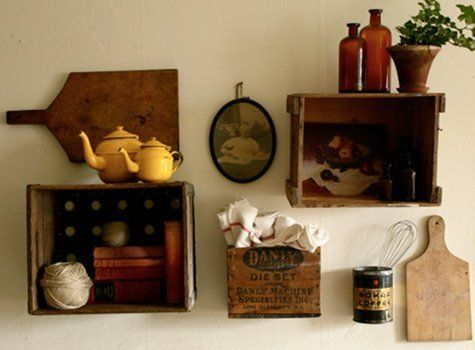 Vintage Crates Turned Shelves - but what I really like are the cutting boards and vintage tea kettles