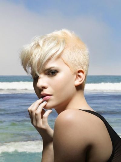 Pixies are here to stay no matter the weather women are just going shorter and shorter but why not revert the whole trend and leave some length up front like this amazingly creative short pixie with longer bangs which looks awesome and is such a nice and creative rendition of short hairstyles.