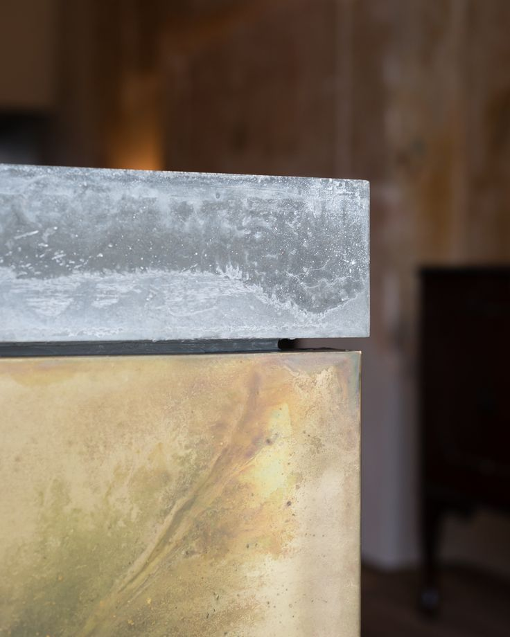 Refurbishment of terraced home in Belsize Park, London. Detail. Materials. Concrete. Patinated Brass. Kitchen.   Interior Design.  Joinery by Goldcrest of London. Photographer - Jim Stephenson. Contractor - Mallett Construction.