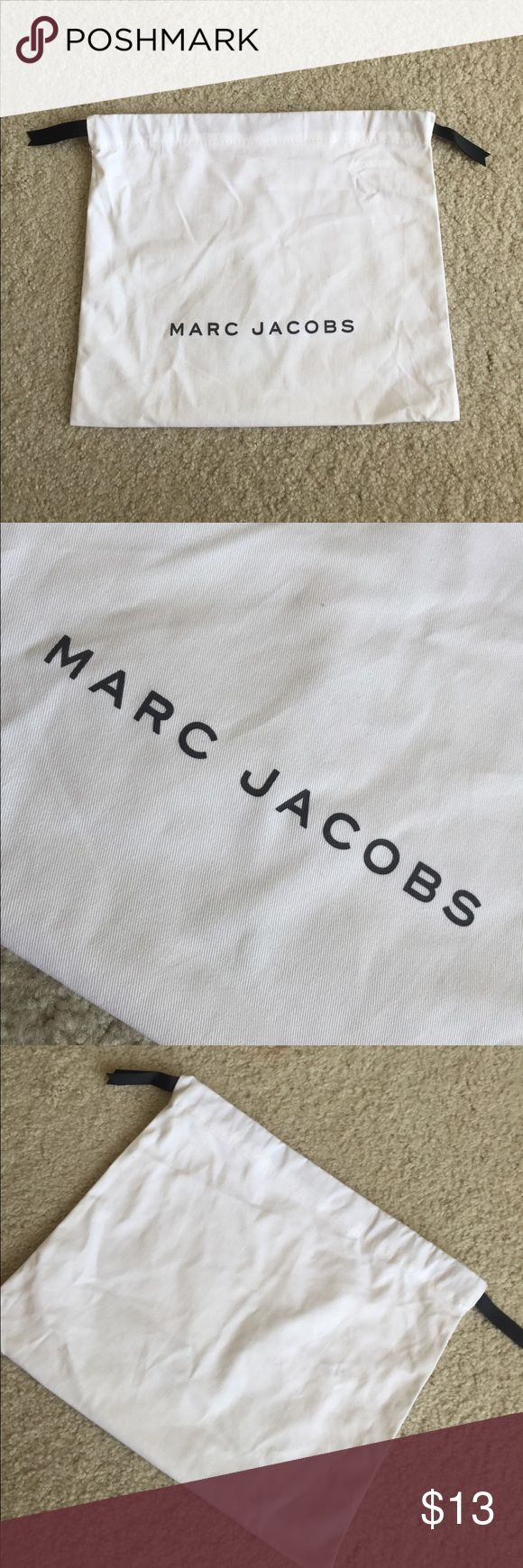 """Marc Jacobs dust bag Never used new. I use my Marc Jacobs purse all the time, dont need to put in dust bag. 13.5*11.5"""". For small sized bag. From authentic Marc Jacobs purse purchase. No trades Marc Jacobs Bags"""