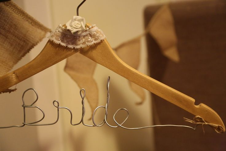 Rustic Elegant Wedding Preparation. Handcrafted 'Bride' wooden coat hanger. To add a personal touch on the day - including homemade elements to your Big Day makes it all the more meaningful.