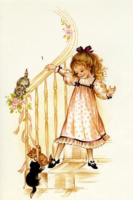 Girl with kittens on a staircase
