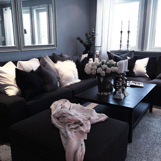 Dark living room!! Candles and flowers at the coffee table. Beautiful grey wall color
