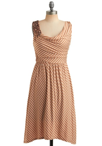 "This might be out of stock but I love it and I hope they bring it back! Name of the dress is ""Got It Parade Dress in Caramel"".. <3"