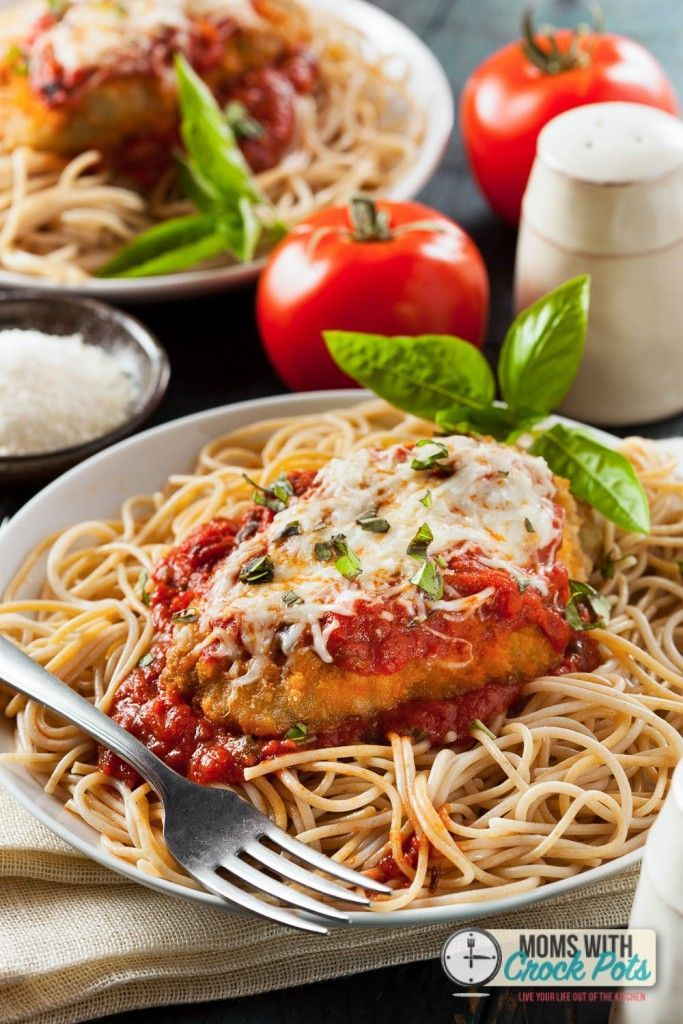 This CrockPot Chicken Parmesan Recipe is one of my all time favorites!! Amazing dish for the crockpot. Comes out moist and flavorful. Such and easy crock pot chicken dinner.