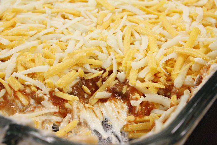 world's best (easy) nacho dip: 1 pkg cream cheese, 1 cup sour cream, ½ tbsp taco seasoning (optional), 1 jar salsa, 1 ½ c shredded cheese. mix first 3 items til well blended, and layer in glass baking dish, spread salsa on top of that, then sprinkle top with cheese. Put in fridge to firm it back up.