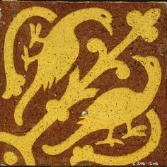 medieval floor tile- Buy cheap canvas drop cloth, create tile stencils, paint it to look like a medieval floor.