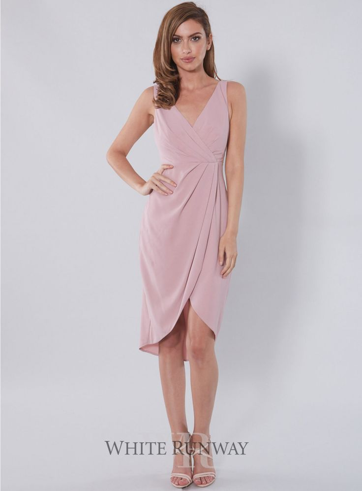 A gorgeous cocktail length dress designed by Leah Da Gloria for White  Runway. A timeless v-neck style featuring a flattering draped over-lay  skirt.