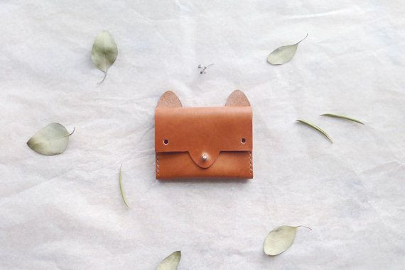 """Made with 3.5oz Horween leather in caramel brown color, waxed nylon thread in natural color, and brass button stud.  The interior has one expanding compartment. Closes with the fox's """"nose"""". #weihnachtsgeschenke #christkind"""