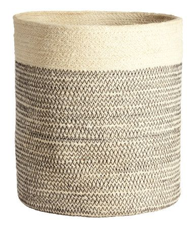 Thick storage basket in jute with handles. Diameter 11 in., height 11 in.