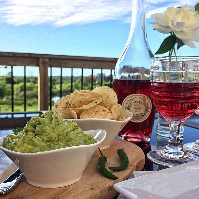 Taking full advantage of summer hours on this beautiful Friday afternoon. Enjoying some spicy guacamole and a nice cold glass of @coppolawine Sofia Rosé @zimmysnook