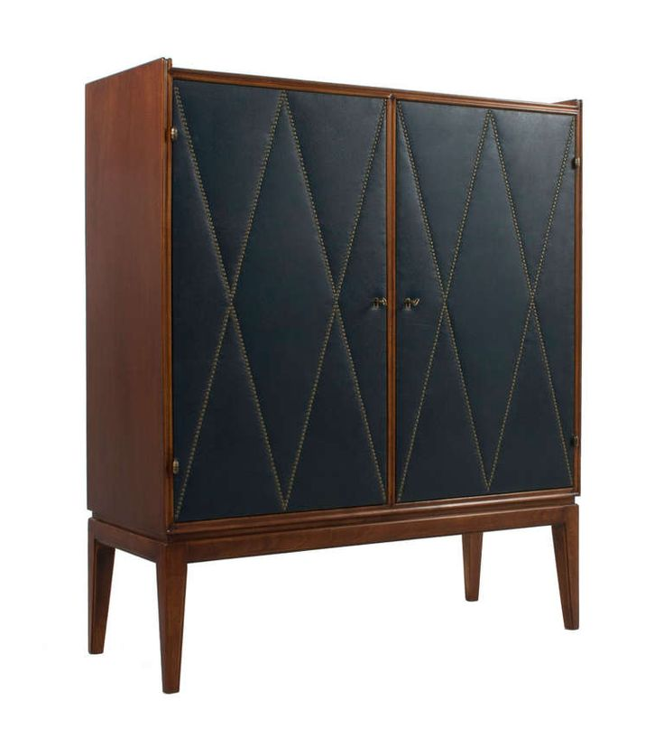 Cabinet by Otto Schultz, Sweden, ca. 1940, in mahogany, brass, and leather.