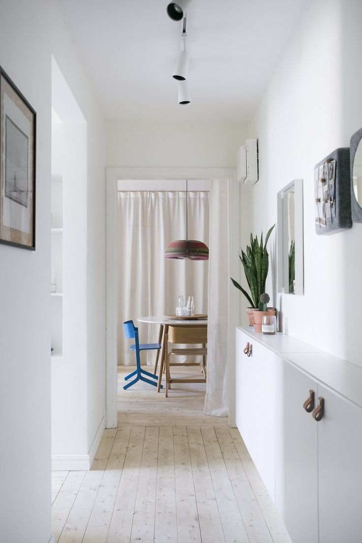 Narrow hallway with Ikea 'Besta' cabinet