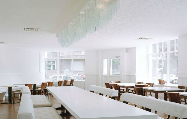 Spectacular Schneeweiss Restaurant in Friedrichshain Berlin Everything is white except the cooks dressed in black and the food is Alps themed